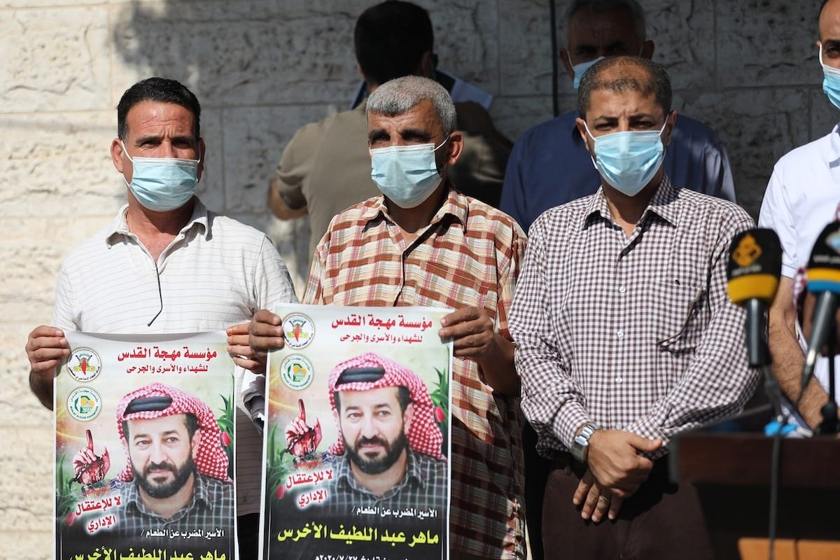 GAZA CITY, GAZA - OCTOBER 12: Palestinians gather in front of International Red Cross building during a demonstration in support of Palestinian prisoner in Israeli jail Maher Al-Akhras, who is in a hunger strike for 78 days, in Gaza City, Gaza on October 12, 2020. ( Mustafa Hassona - Anadolu Agency )