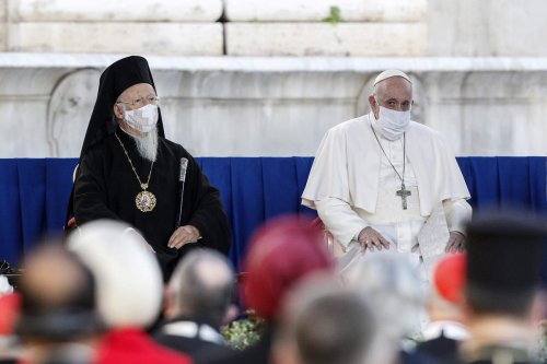 """Bartholomew I, Patriarch of Constantinople (L) and Pope Francis (R) wear protective masks as they attend an international Prayer for Peace initiative entitled """"No One Is Saved Alone - Peace and Fraternity"""" at the Capitoline Hill in Rome, Italy, on October 20, 2020 [Riccardo De Luca / Anadolu Agency]"""
