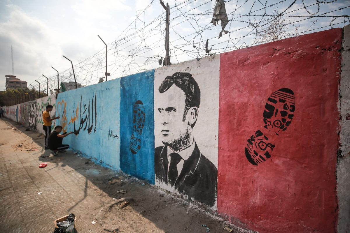 A mural depicting French President Emmanuel Macron painted on a wall as a reaction over his anti-Islam remarks, at Nuseirat Camp in Gaza City, Gaza on October 28, 2020 [Mustafa Hassona / Anadolu Agency]