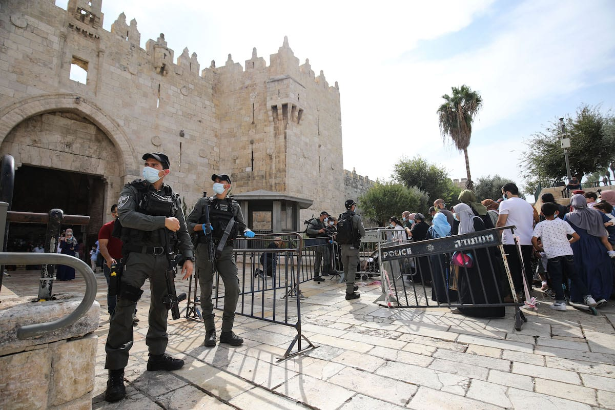 Palestinians queue in front of the gate at Old Town district to enter Masjid Al-Aqsa to attend the events of Mawlid al-Nabi, the birth anniversary of Muslims' beloved Prophet Mohammad in Jerusalem on 29 October 2020. [Mostafa Alkharouf - Anadolu Agency]