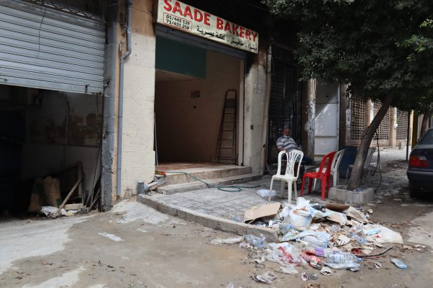 A man sits outside his bakery a month after Beirut explosion which rocked the capital city on 4 August 2020, taken on 23 September 2020