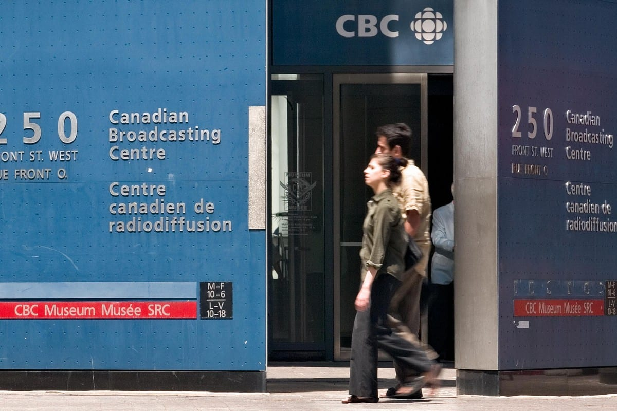Pedestrians walk in front of the Canadian Broadcasting Corporation (CBC) building in Toronto, Canada [GEOFF ROBINS/AFP/Getty Images]