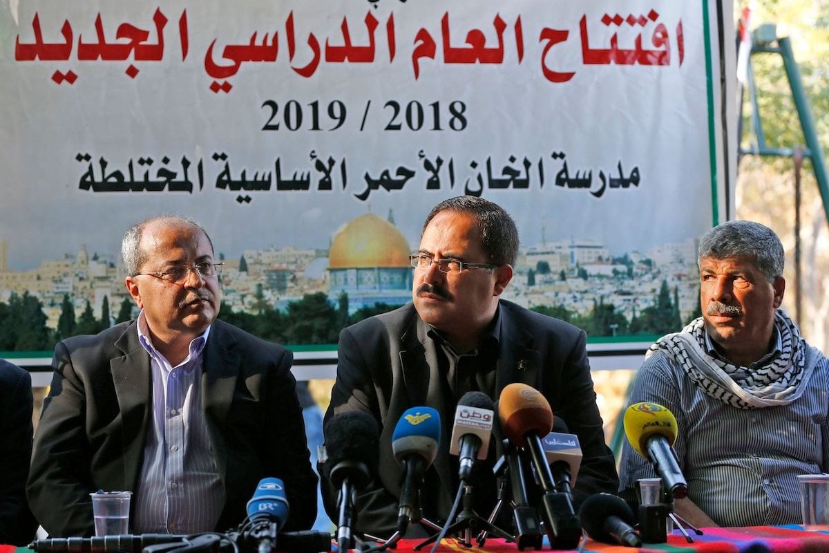 Sabri Saidam, senior Fatah official and the Palestinian Minister of Education, speaks during an event marking the early start of classes in the Bedouin village of Khan al-Ahmar in the occupied West Bank on 16 July 2018. [ABBAS MOMANI/AFP via Getty Images]