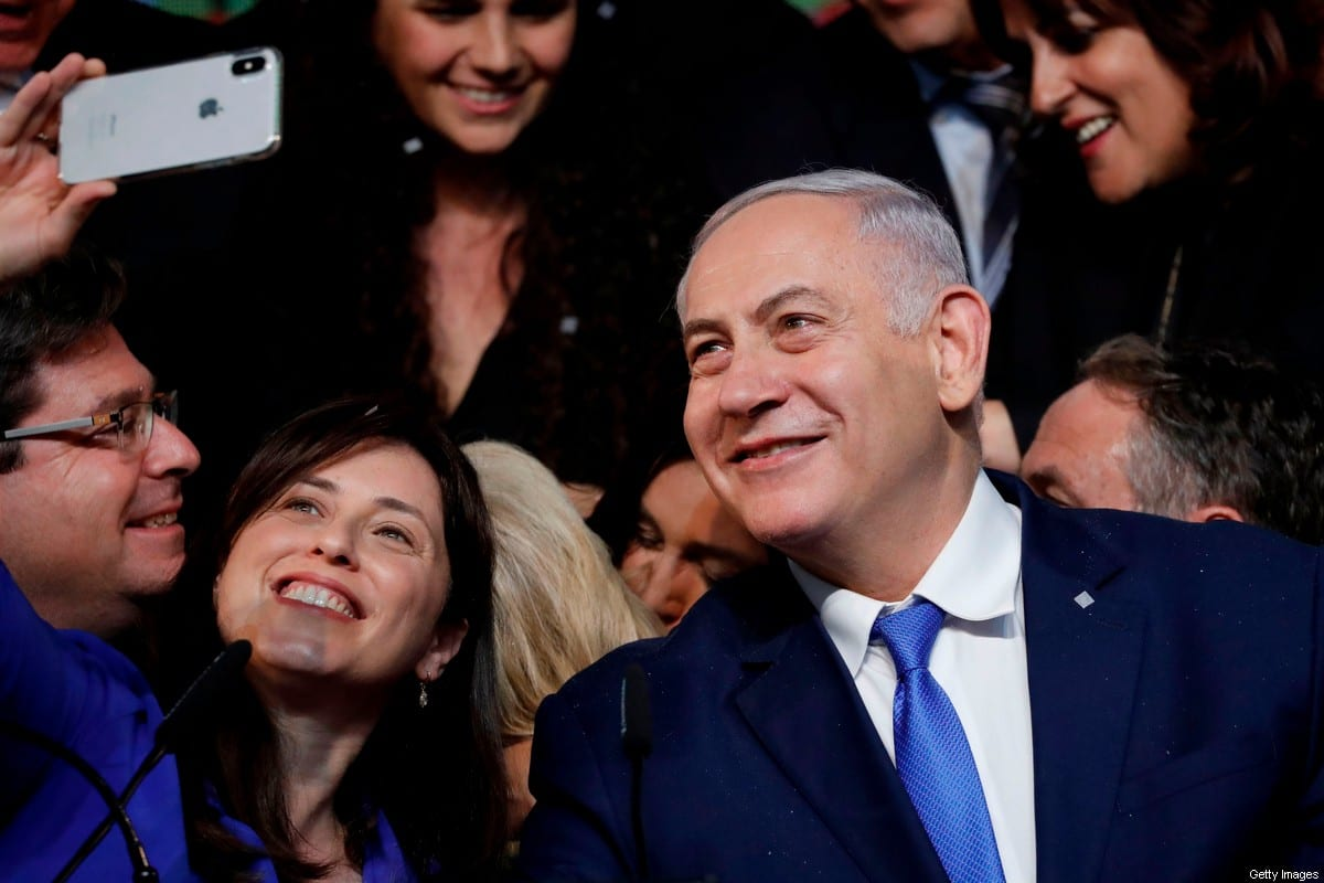 Israeli Prime Minister Benjamin Netanyahu (R) and Israeli Deputy Foreign Minister Tzipi Hotovely pose for a selfie on election night at his Likud Party headquarters in the Israeli coastal city of Tel Aviv early, on April 10, 2019 [THOMAS COEX/AFP via Getty Images]