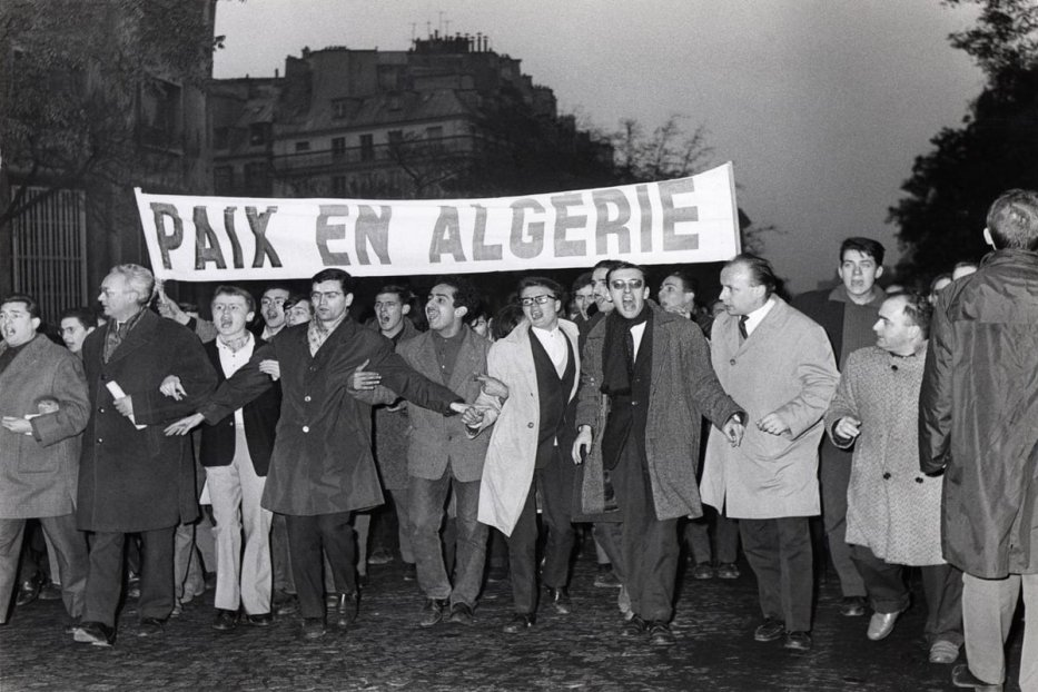 Protesters in favour of the independence of Algeria are seen marching in Paris in 1961 [AFP via Getty Images]