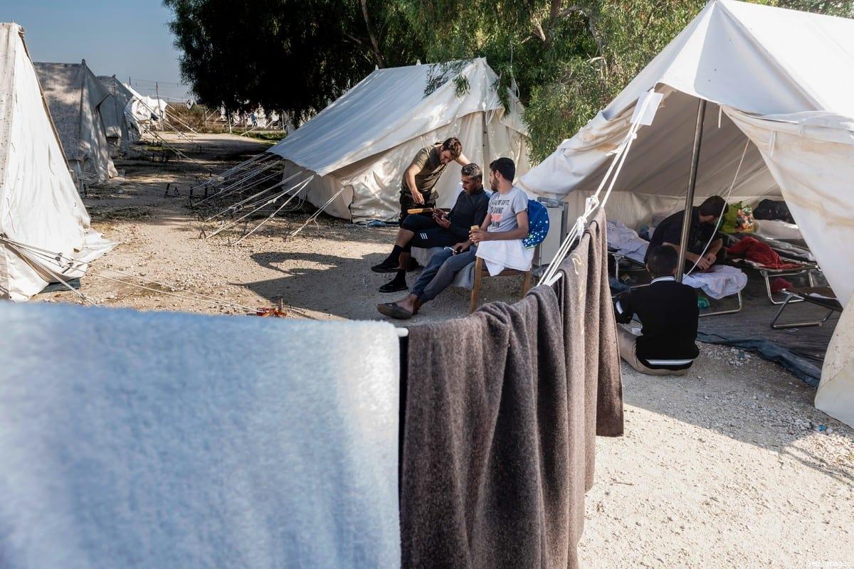 Syrian refugees inside a refugee camp on 5 November 2019 [IAKOVOS HATZISTAVROU/AFP/Getty Images]