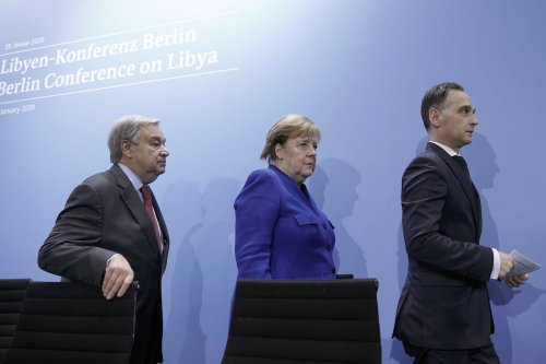 (LtoR) Secretary-General of the United Nations (UN) Antonio Guterres; German Chancellor Angela Merkel and German Foreign Minister Heiko Maas leave after a press conference at the end of a Peace summit on Libya at the Chancellery in Berlin on 19 January 2020. [MICHAEL KAPPELER/POOL/AFP via Getty Images]