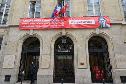 A banner with a portrait of French-Iranian academic Fariba Adelkhah, imprisoned in Iran, hangs on the facades of the French university Sciences Po, in Paris, on June 5, 2020 [BERTRAND GUAY/AFP via Getty Images]