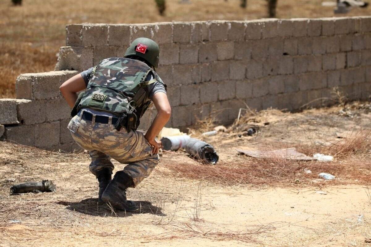 A Turkish military de-miner searches for landmines in the Salah al-Din area, south of the Libyan capital Tripoli, on June 15, 2020 [MAHMUD TURKIA/AFP via Getty Images]