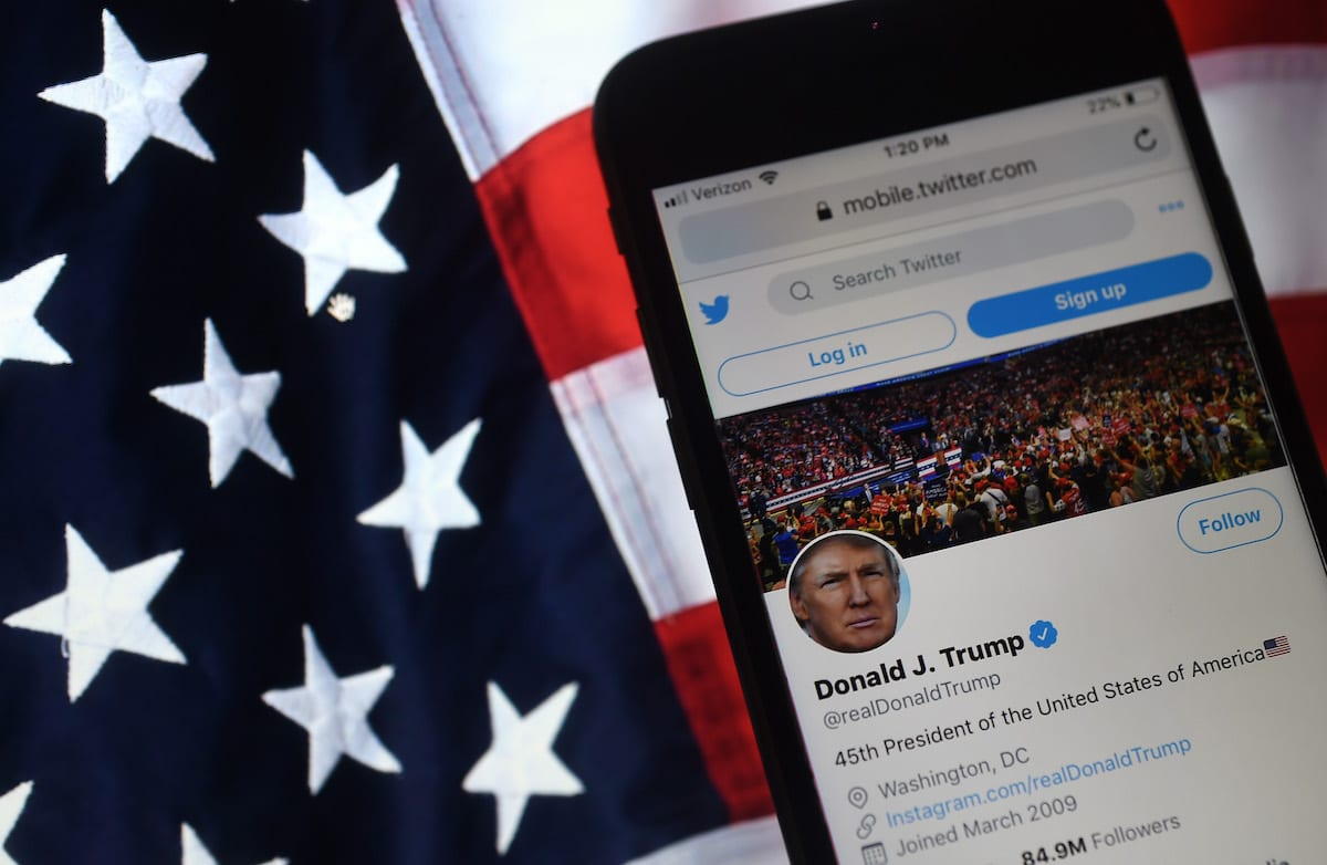 In this photo illustration, the Twitter account of US President Donald Trump is displayed on a mobile phone on 10 August 2020, in Arlington, Virginia. [OLIVIER DOULIERY/AFP via Getty Images]