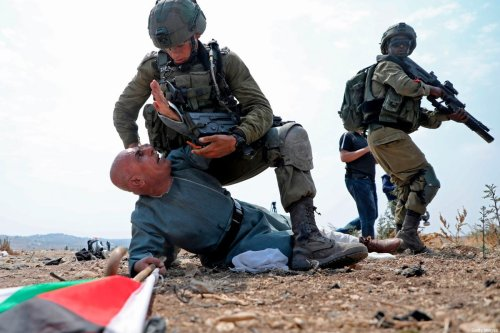 Israeli soldiers detain a Palestinian protester during a demonstration against the Israeli settlement expansion in the village of Jbara, south of Tulkarm in the occupied West Bank, on 1 September 2020. [JAAFAR ASHTIYEH/AFP via Getty Images]