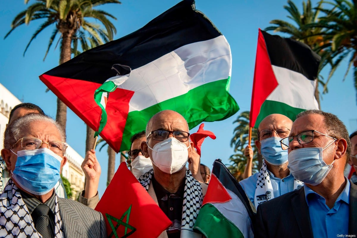 Moroccans wave the Palestinian flag during a demonstration in the capital Rabat on September 18, 2020, to denounce the Israeli normalisation deals with the United Arab Emirates and Bahrain. [FADEL SENNA/AFP via Getty Images]