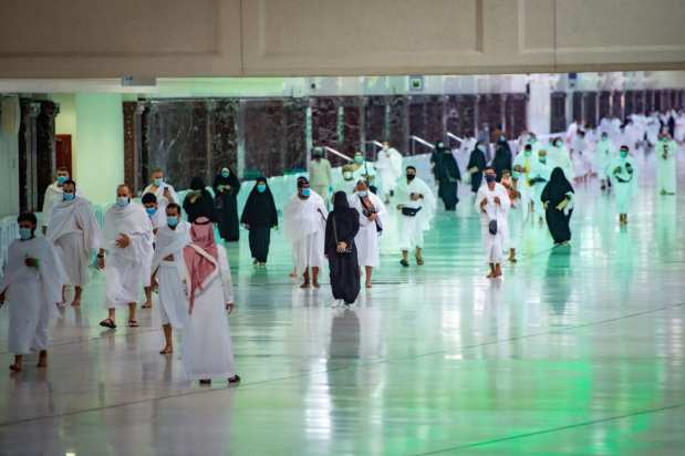 Saudis and foreign residents perform the Umrah pilgrimage, in the Grand Mosque complex in the holy city of Makkah, on October 4, 2020 [Saudi Ministry of Hajj and Umra/AFP via Getty Images]