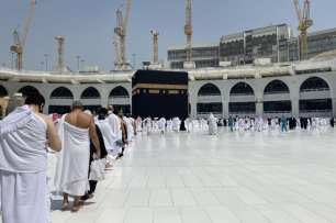 Saudis and foreign residents circumambulate the Kaaba (Tawaf), as part of the Umrah pilgrimage, in the Grand Mosque complex in the holy city of Makkah, on October 4, 2020 [Saudi Ministry of Hajj and Umra/AFP via Getty Images]