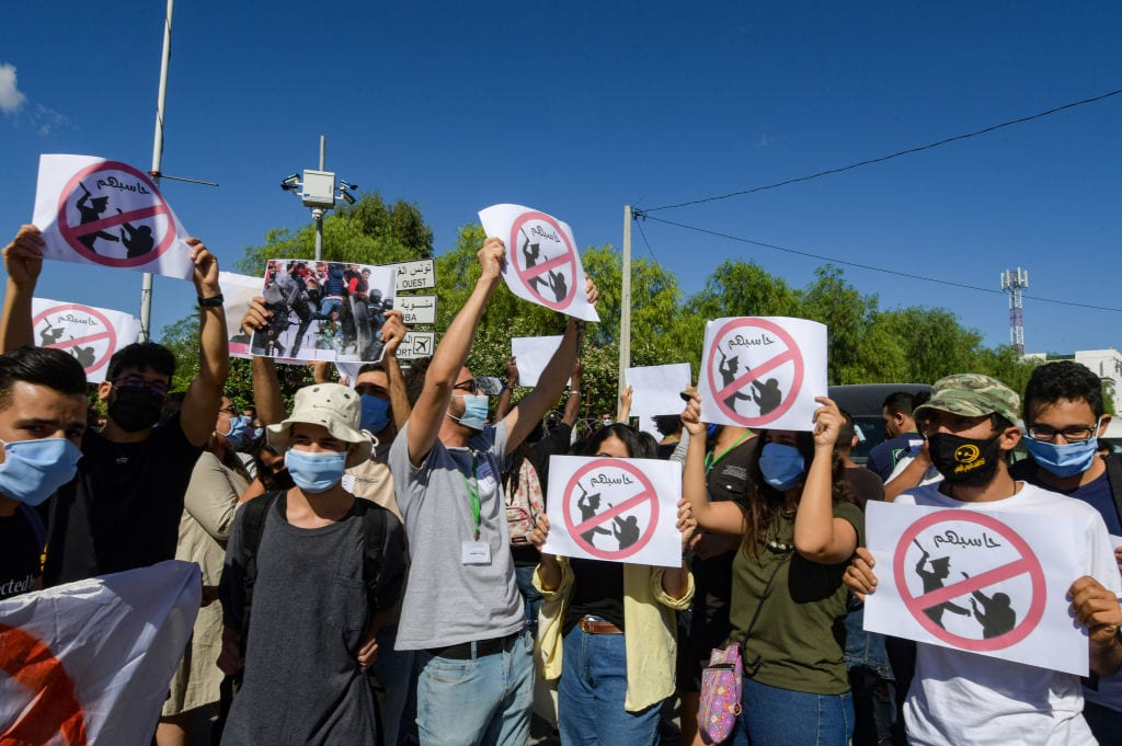 Tunisians take part in a protest, part of the Hassebhom campaign, which translate to Hold Them Accountable, outside the Parliament headquarters in the capital Tunis on October 6, 2020 [FETHI BELAID/AFP via Getty Images]