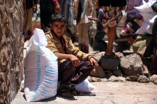 A Yemeni boy receives humanitarian aid Taizz, Yemen, on 10 October 2020 [AHMAD AL-BASHA/AFP/Getty Images]