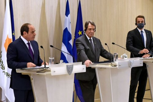 (L to R) Egyptian President Abdel Fattah al-Sisi, Cypriot President Nicos Anastasiades, and Greek Prime Minister Kyriakos Mitsotakis give a joint press conference after their trilateral summit at the presidential palace in Cyprus' capital Nicosia on 21 October 2020. [IAKOVOS HATZISTAVROU/POOL/AFP via Getty Images]