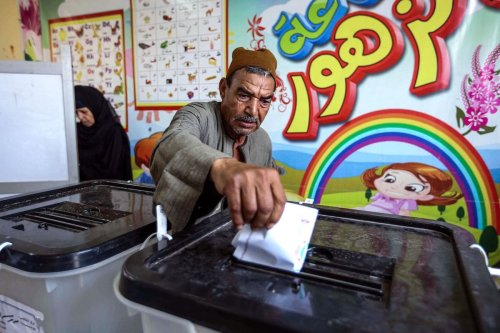 A man casts his ballot at a polling station in El-Ayyat, south of the Egyptian capital on 24 October 2020, during the first stage of the lower house elections. [KHALED KAMEL/AFP via Getty Images]