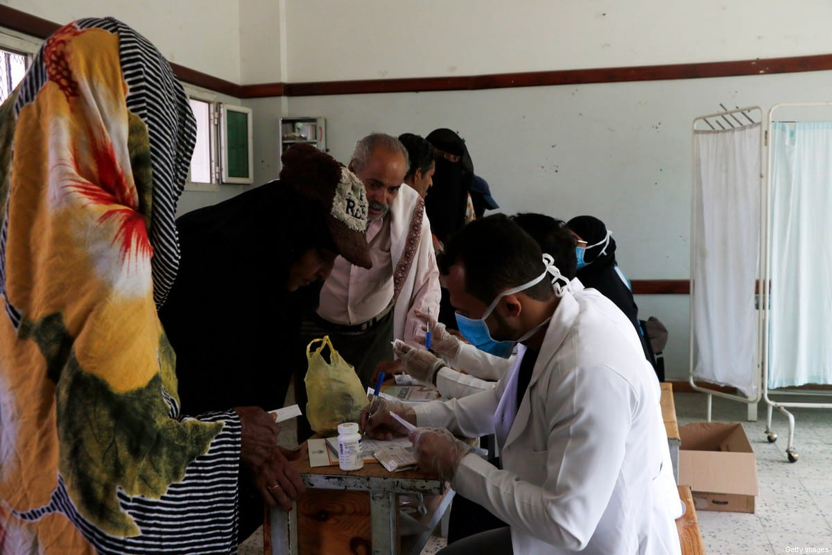 A volunteer doctor offers poor persons free medical treatments and medicines through an initiative staged by volunteer doctors on 9 July 2020 in Sana'a, Yemen. Mohammed Hamoud/Getty Images