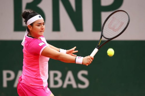Ons Jabeur of Tunisia plays a backhand during her Women's Singles third round match against Aryna Sabalenka of Belarus on day seven of the 2020 French Open at Roland Garros on October 03, 2020 in Paris, France [Julian Finney/Getty Images]