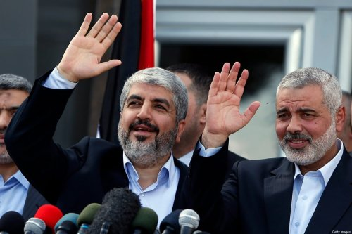 Hamas leaders Khaled Meshaal (L) and Ismail Haniya (R) wave during a press conference following Meshaal's arrival in Rafah, southern Gaza, on December 7, 2012 [SUHAIB SALEM/AFP via Getty Images]
