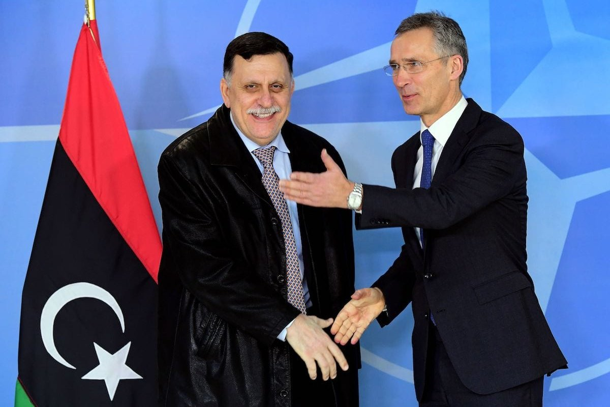 NATO Secretary General Jens Stoltenberg (R) welcomes Fayez al-Sarraj, head of Libya's Tripoli-based Government of National Accord, at the NATO headquarters in Brussels on 1 February 2017. [EMMANUEL DUNAND/AFP via Getty Images]