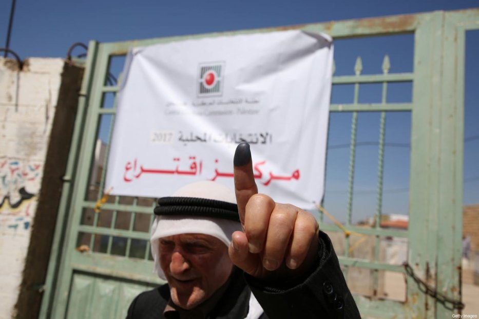 A Palestinian man shows his ink-stained finger after casting his ballot during the municipal elections in the village of Tammun, east of Nablus in the Israeli-occupied West Bank, on 13 May 2017. [JAAFAR ASHTIYEH/AFP via Getty Images]