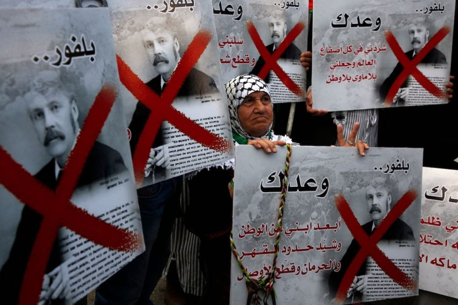A Palestinian demonstrator carries a placard bearing the portrait of former British Prime Minister Arthur Balfour during a demonstration in northern West Bank city of Nablus on 2 November 2017, on the 100th anniversary of Britain's Balfour Declaration, which helped lead to Israel's creation and the Israeli-Palestinian conflict. [JAAFAR ASHTIYEH/AFP via Getty Images]