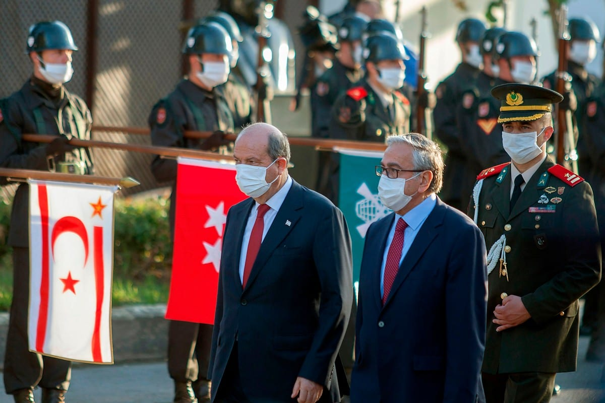 Outgoing Turkish-Cypriot leader Mustafa Akinci (R) and the newly elected leader Ersin Tatar, arrive at a handover ceremony in the northern part of Nicosia, the capital of the self-proclaimed Turkish Republic of Northern Cyprus (TRNC), on 23 October 2020 [BIROL BEBEK/AFP/Getty Images]