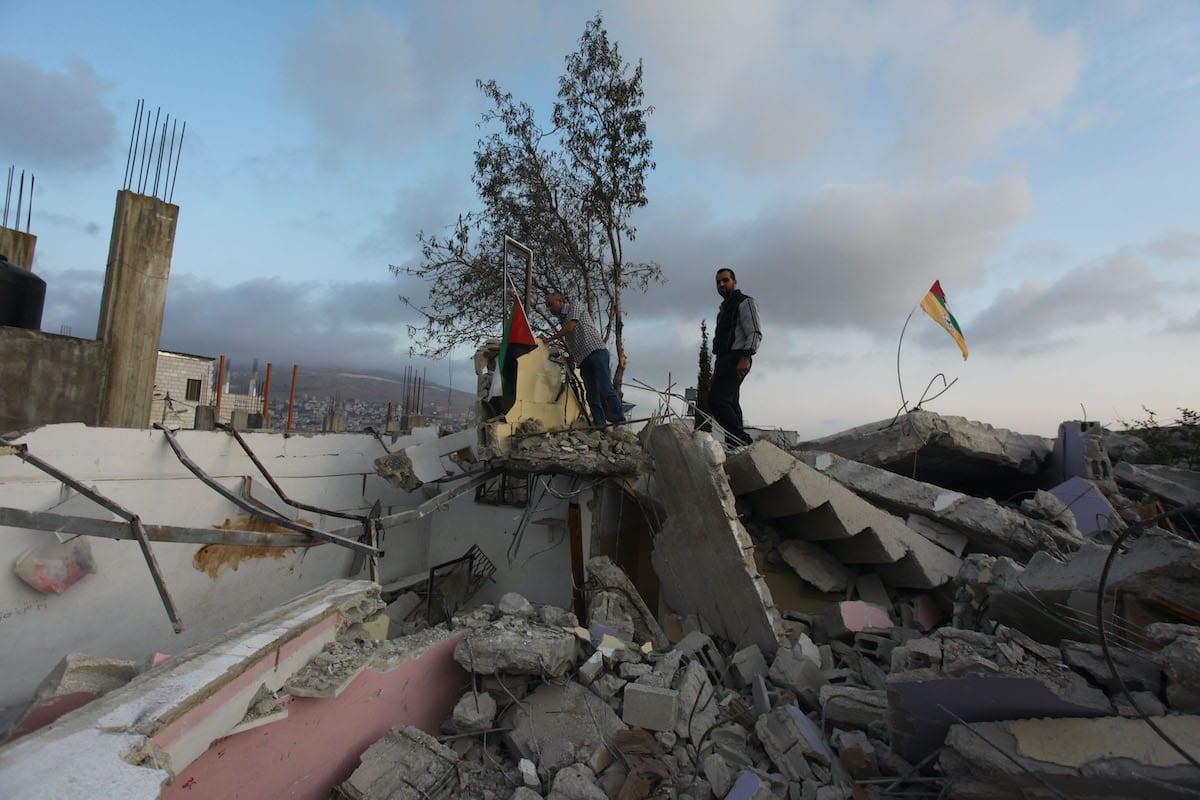 NABLUS, WEST BANK - NOVEMBER 2: Palestinians inspect debris of the house of Palestinian prisoner Halil Duveykat after Israeli forces demolished it in Ruceyb town of Nablus, West Bank on November 2, 2020. ( Nedal Eshtayah - Anadolu Agency )