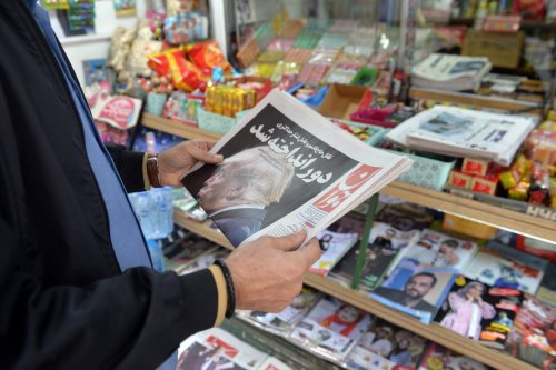 An Iranian citizen reading the news regarding the US elections in newspapers, on November 09, 2020 in Tehran, Iran [Fatemeh Bahrami/Anadolu Agency]