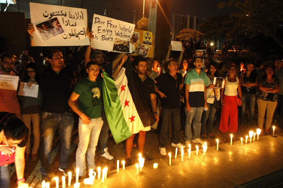 Protest against the Assad Regime outside the UN headquarters in Beirut, Lebanon on 21 August 2013 [STR/AFP/Getty Images]