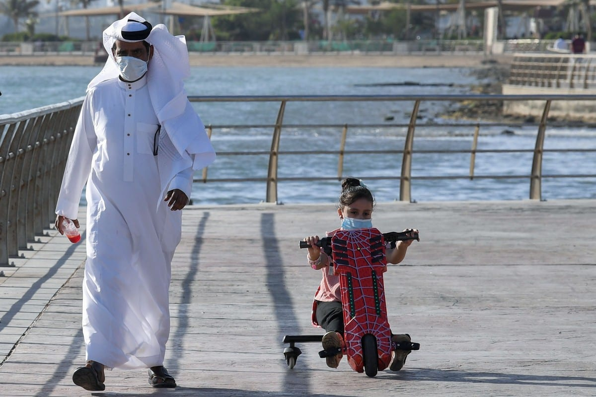 A Saudi man and his daughter stroll down the seafront Jeddah, Saudi Arabia on 21 June 2020 [AMER HILABI/AFP/Getty Images]