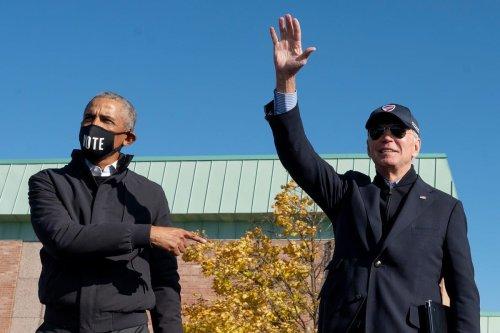 Former US President Barack Obama (L) and President-elect Joe Biden in Michigan, US on 31 October 2020 [JIM WATSON/AFP/Getty Images]