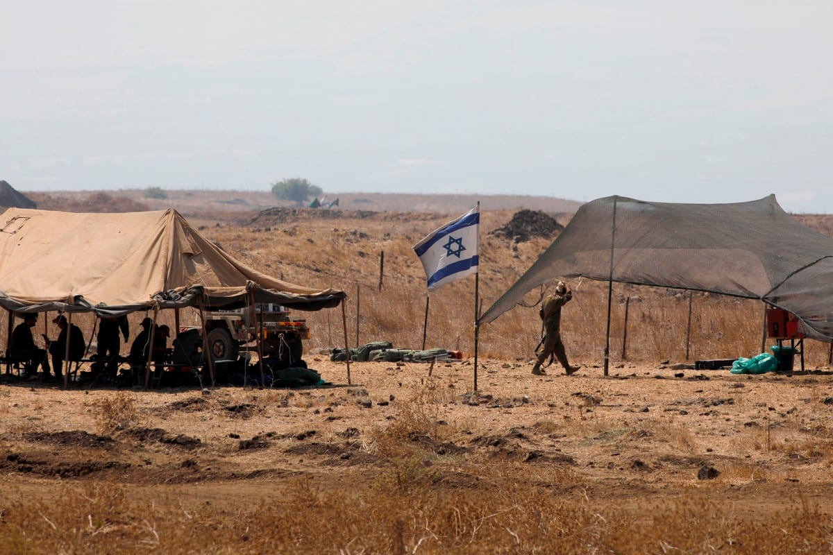 Israeli soldiers can be seen at the Israeli-annexed Golan Heights on 1 September 2020 [JALAA MAREY/AFP/Getty Images]