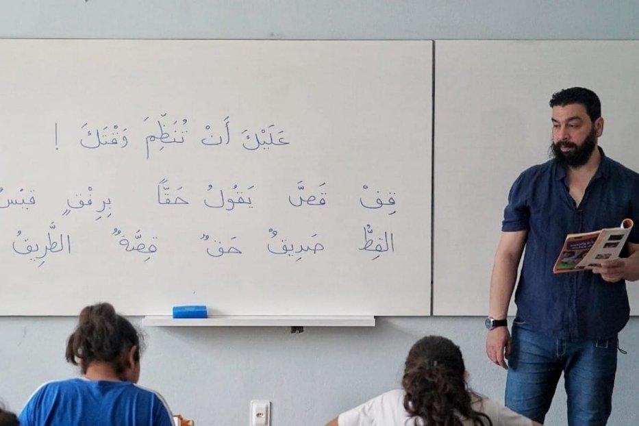 Mohammed Al-Assad teaching Arabic in Florianopolis, Brazil, November 2019 [Photo by Eman Abusidu]