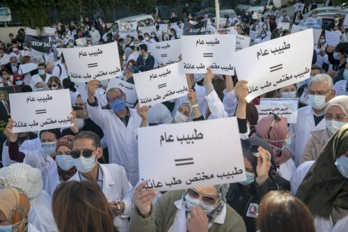 TUNIS, TUNISIA - DECEMBER 1: Tunisian general practitioners stage a protest against the application of a government decree No. 341, which sets the framework of the conditions for obtaining medical diplomas as they begin a four-day strike, in Tunis, Tunisia on December 1, 2020. ( Yassine Gaidi - Anadolu Agency )