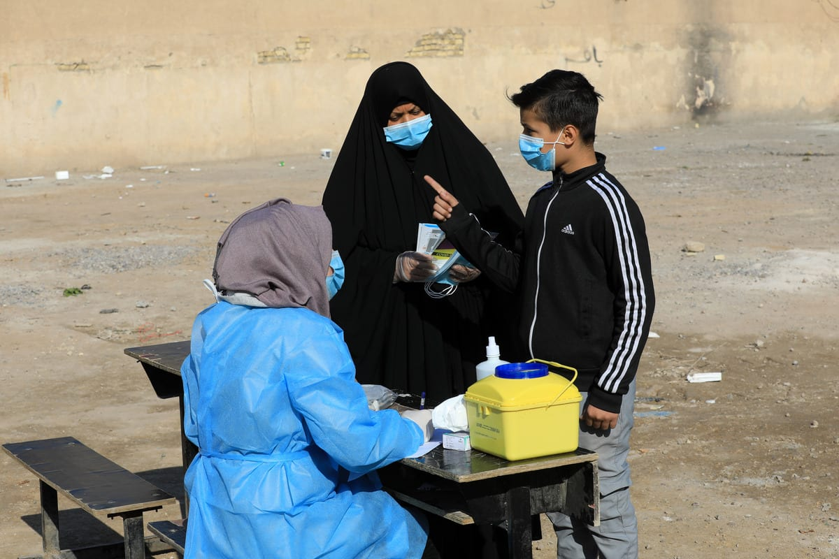 A health official takes samples for a COVID-19 test in Baghdad, Iraq on 6 December 2020 [Murtadha Al-Sudani/Anadolu Agency]