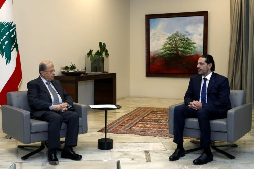 Lebanon's Prime Minister-designate Saad al-Hariri (R) and Lebanese President, Michel Aoun (L) are seen during a meeting as Saad al-Hariri presented President Michel Aoun with a line-up of 18 members of cabinet at Baabda Presidential Palace in Beirut, Lebanon on 9 December 2020. [Lebanese Presidency - Anadolu Agency]