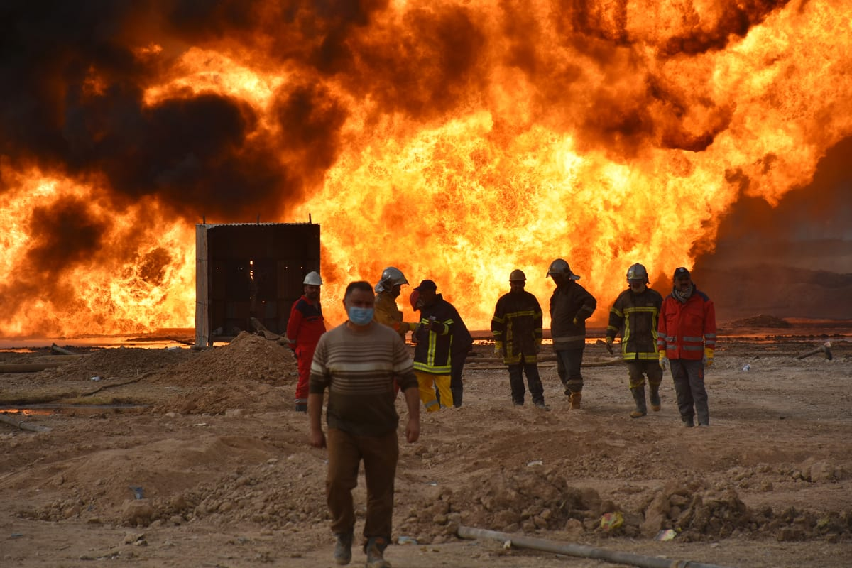 KIRKUK, IRAQ - DECEMBER 15: Firefighter teams conduct extinguish works after the Daesh carried out a bomb attack on wells in the Habbaza oil field in the Kirkuk province of Iraq on December 15, 2020. ( Ali Makram Ghareeb - Anadolu Agency )