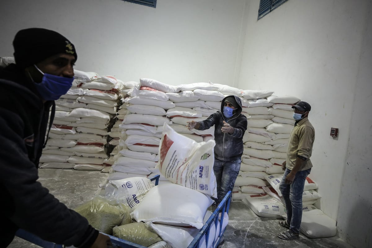 JABALIA, GAZA - DECEMBER 17: Workers of United Nations Palestine Refugee Agency (UNRWA) package humanitarian aid coming from different countries for Palestinian refugees to distribute them in Jabalia, Gaza on December 17, 2020. ( Ali Jadallah - Anadolu Agency )