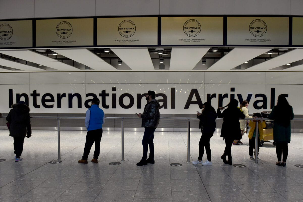 People wait for arrivals at Terminal 5 of Heathrow Airport in west London on 21 December 2020, as a string of countries around the world banned travellers arriving from the UK, due to the rapid spread of a new, more-infectious coronavirus strain. [Kate Green - Anadolu Agency]