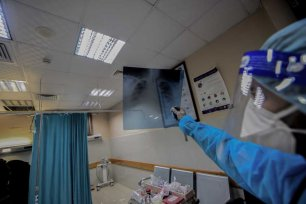 Healthcare staff in Nasser Hospital in the city of Khan Yunis are seen working with overalls, masks, glasses to minimize the risk of contamination during work in Gaza, on 22 December 2020. [Abed Zagout -Anadolu Agency]