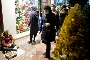 Shoppers observe Christmas-themed window display of a store in a neighbourhood with a large Christian population in Tehran, Iran, on December 22, 2020 [Fatemeh Bahrami / Anadolu Agency]