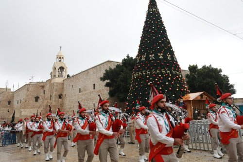 Palestinian marching band parade as part of Christmas celebrations in Bethlehem, West Bank on December 24, 2020 [Issam Rimawi / Anadolu Agency]
