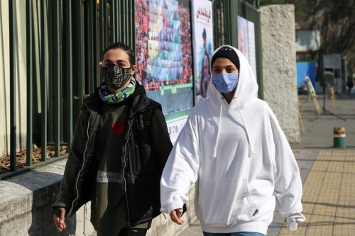 TEHRAN, IRAN - DECEMBER 29: People wear face masks as a preventive measure against the coronavirus (COVID-19) as daily life continues in the country amid COVID-19 pandemic Iran, on December 29, 2020 in Tehran, Iran. Iran reported 132 deaths in the last 24 hours, raising the COVID-19 death toll to 54, 946. ( Fatemeh Bahrami - Anadolu Agency )