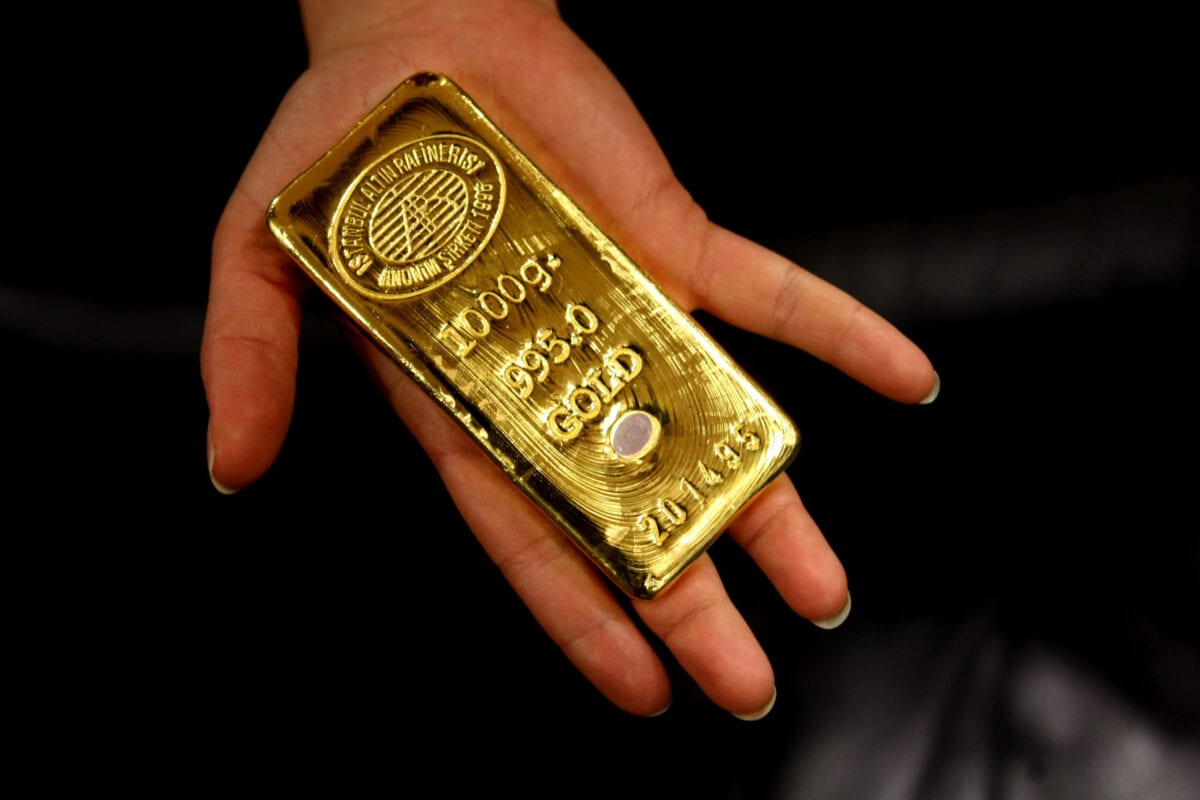 A worker shows a gold bar ready for sale in Istanbul Gold Refinery, after being melted in the refinery, on February 10, 2009. After the Turkish Lira gained in value against the gold price, Turkish people start selling their homestocked gold. AFP PHOTO / MUSTAFA OZER (Photo credit should read MUSTAFA OZER/AFP via Getty Images)