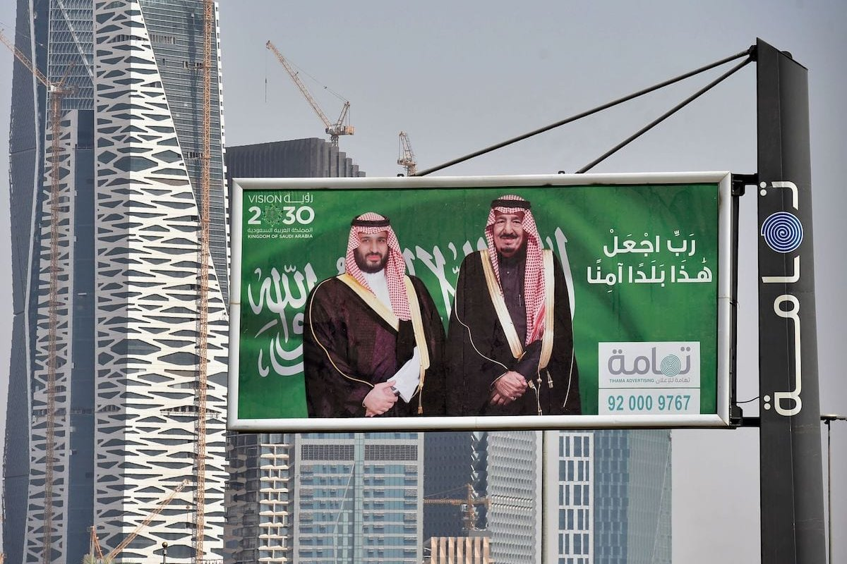 Portraits of Saudi King Salman (R) and his son Crown Prince Mohammed bin Salman (MBS) in Riyadh one day before the Future Investment Initiative FII conference that will take place in Riyadh from 23-25 October, on 22 October 2018 [FAYEZ NURELDINE/AFP via Getty Images]