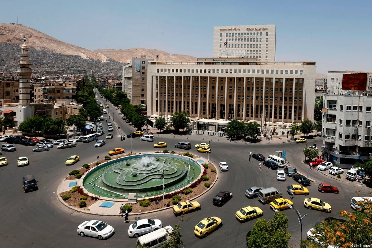 Vehicles drive along the roundabout past the Central bank of Syria in the capital Damascus' Sabaa Bahrat Square on June 17, 2020 [LOUAI BESHARA / AFP via Getty Images]