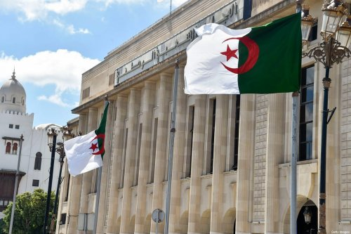 Algerian flags flutter in front of the People's National Assembly (parliament) building in the capital Algiers, on 10 September 2020 [RYAD KRAMDI/AFP/Getty Images]